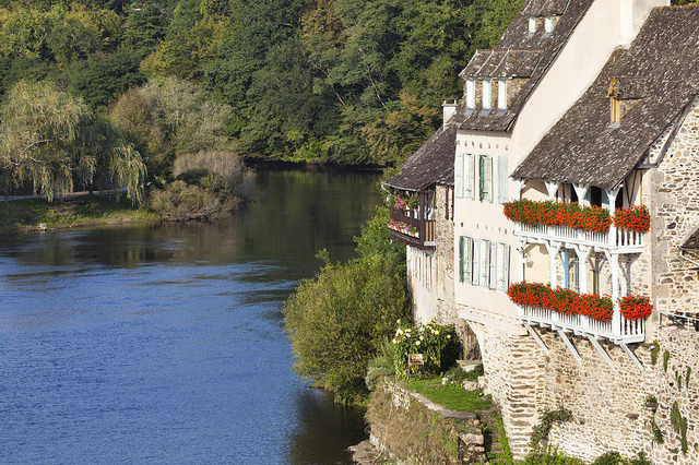 Beautiful houses on the shores of Dordogne river in Argentat, France