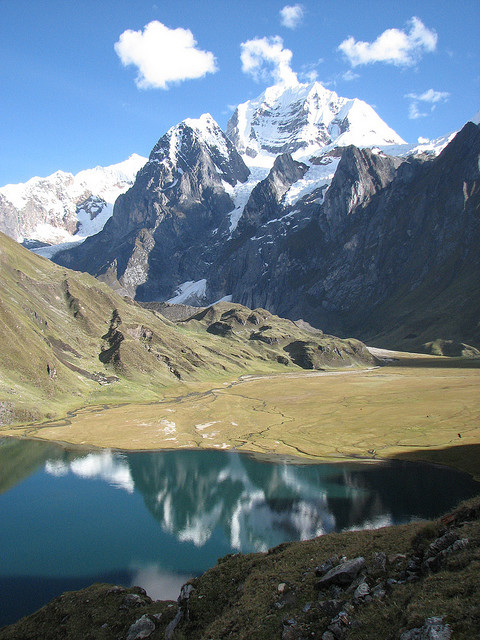 Reflections on a glacier lake in Huayhuash Range, Peru