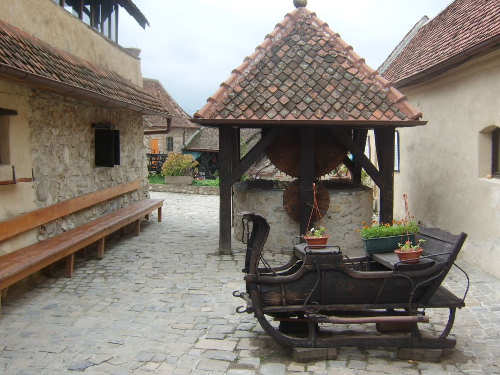 The old fountain inside Rasnov Fortress, carved in solid rock by two otoman prisoners for 17 years, near Brasov, Romania