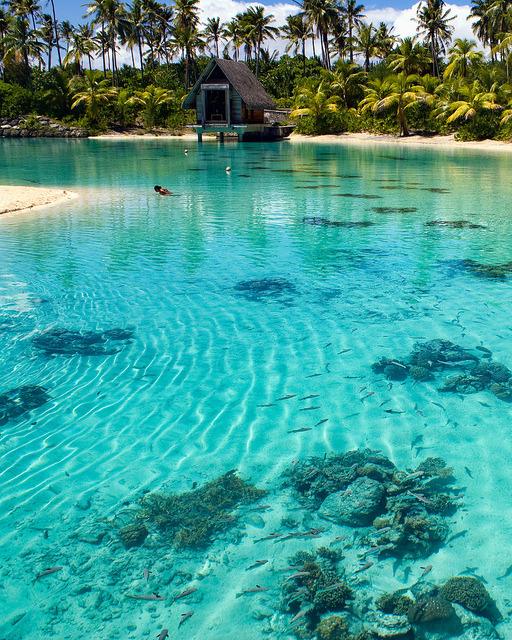 Turqoise waters of Bora Bora lagoon in French Polynesia