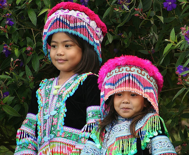 Little sisters in hilltribe costumes in Chiang Mai, Thailand