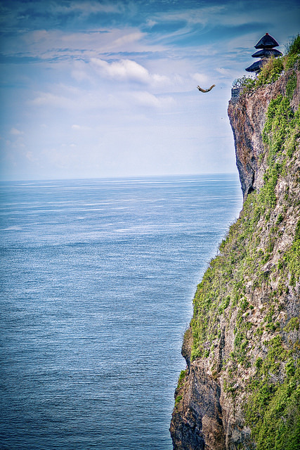 Cliff diving from Uluwatu Temple, Bali / Indonesia